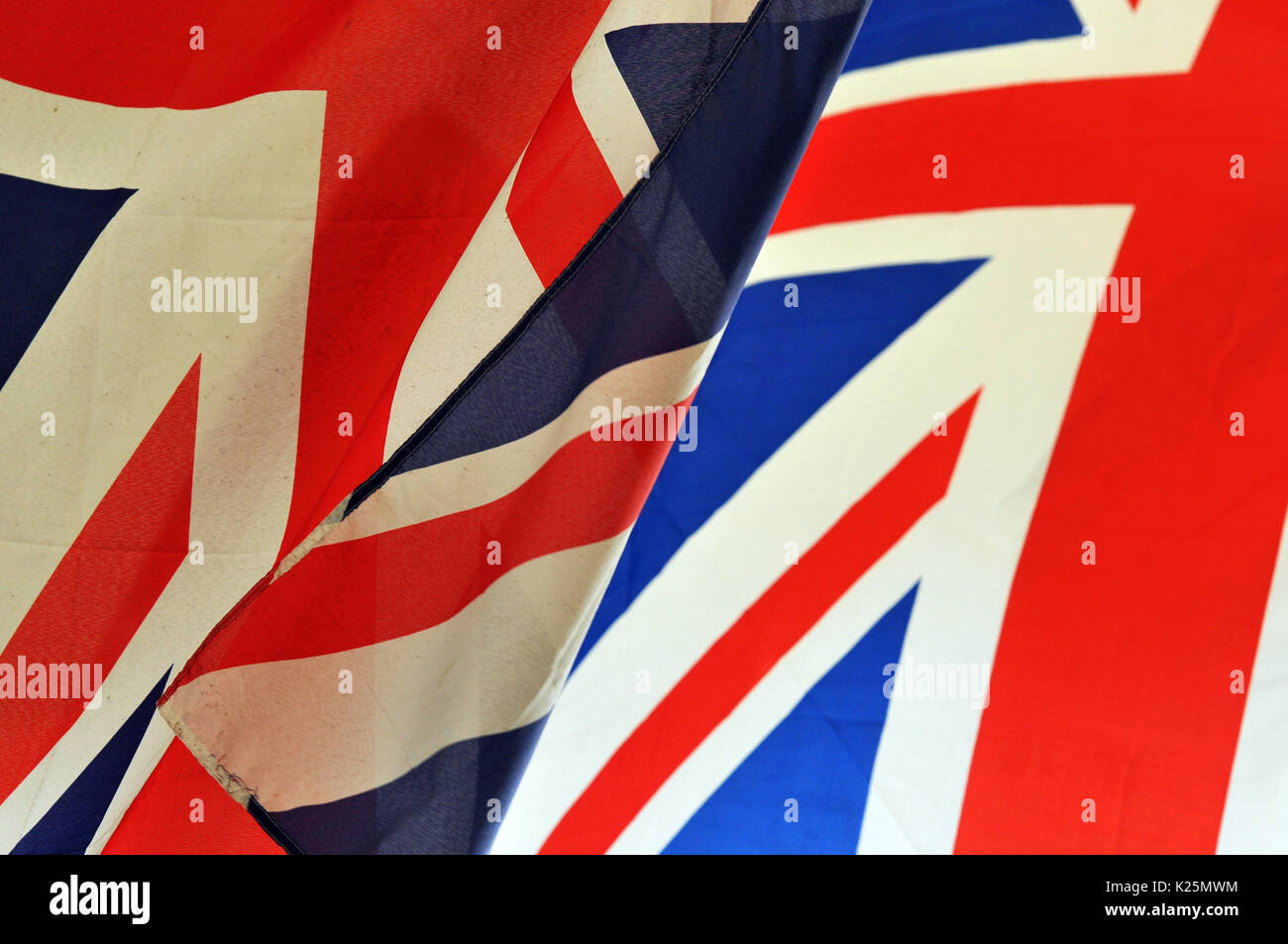 union flags and jacks banners and patriotic national symbols and emblems - Stock Image