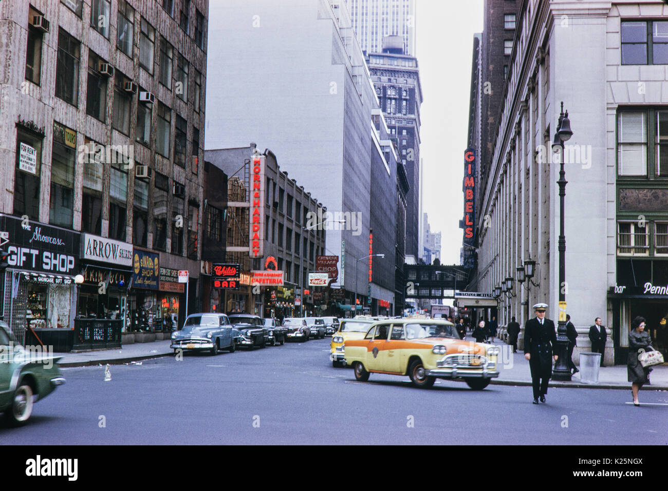 New York City Street scene. 1962 Statner, Hilton and Gimbles. - Stock Image