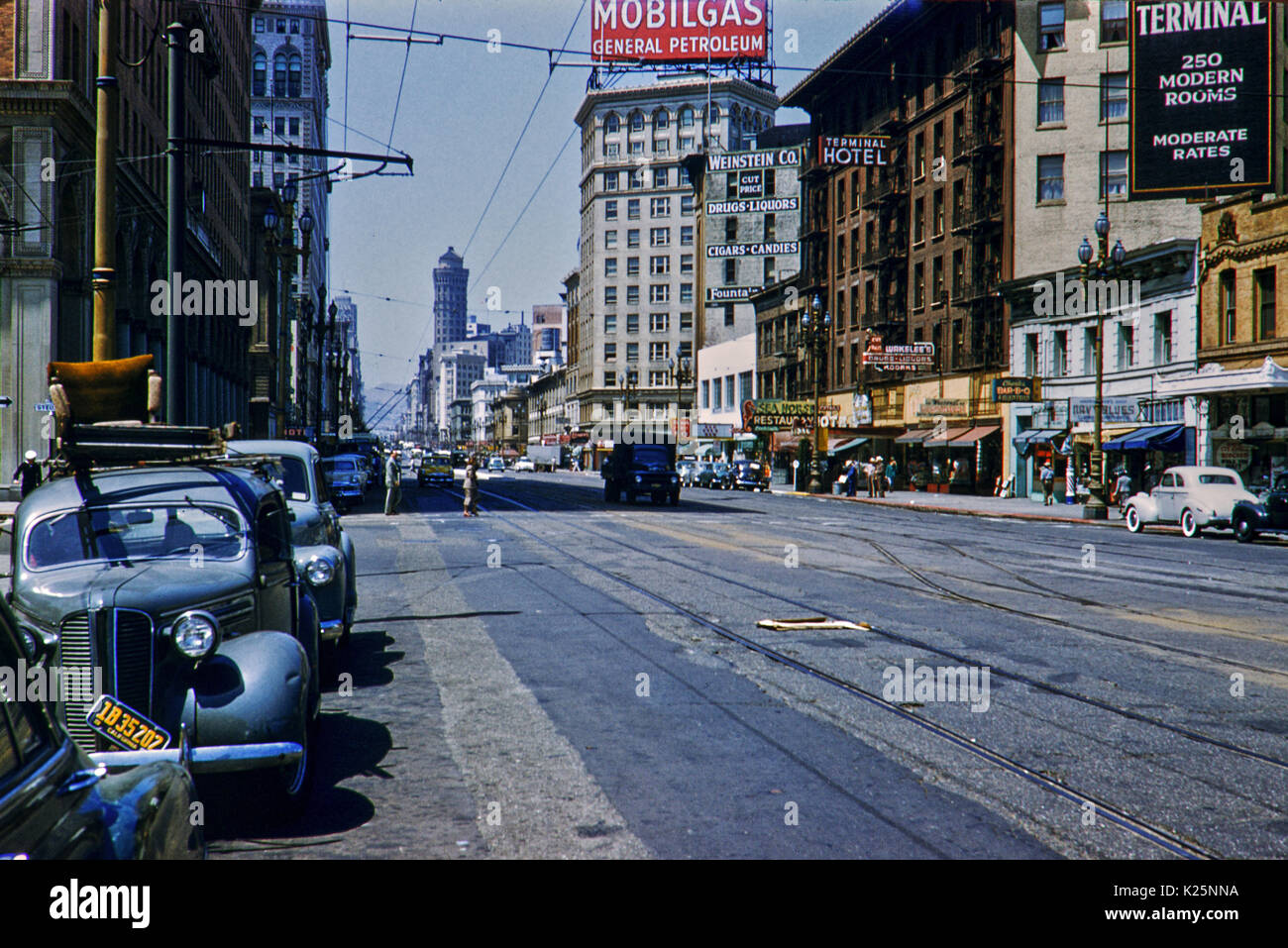San Francisco Street Scene 1950s Terminal Hotel and Mobil Gas sign. - Stock Image