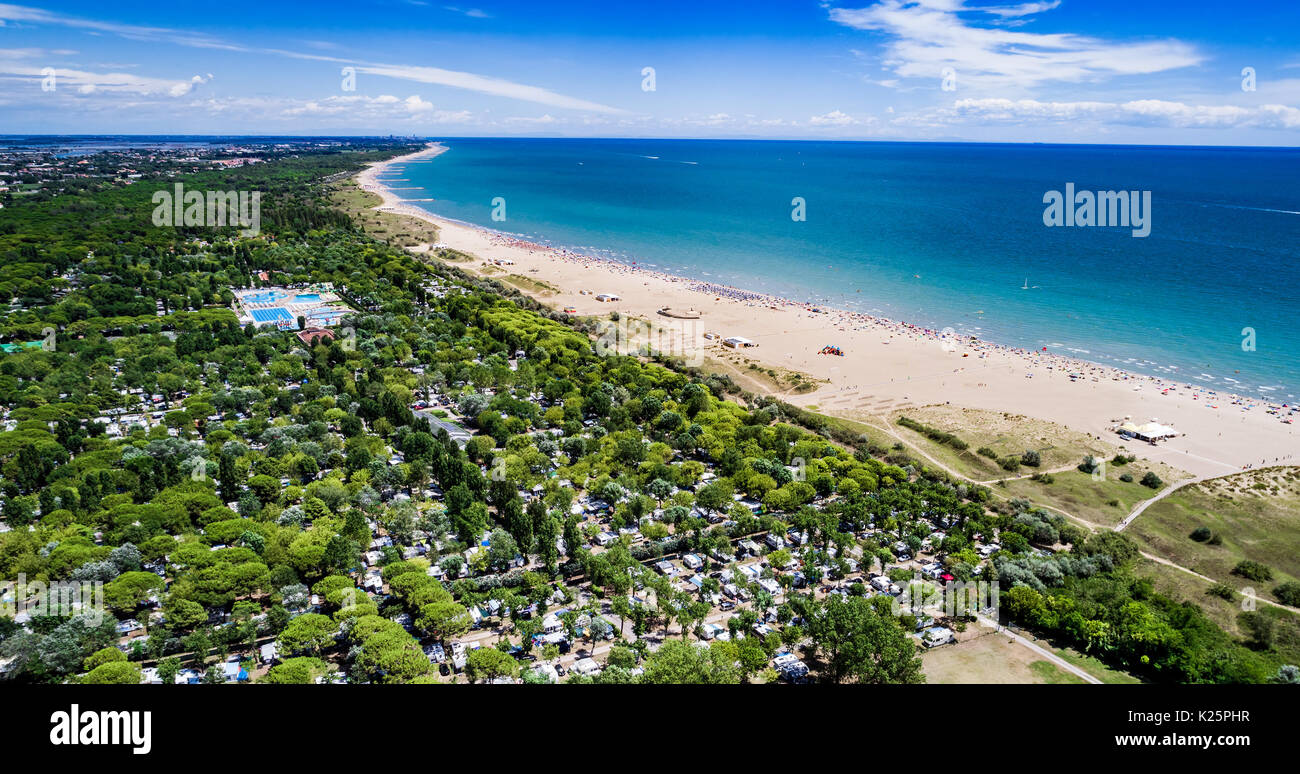 Italy, the beach of the Adriatic sea. Rest on the sea near Venice. Aerial FPV drone photography. - Stock Image