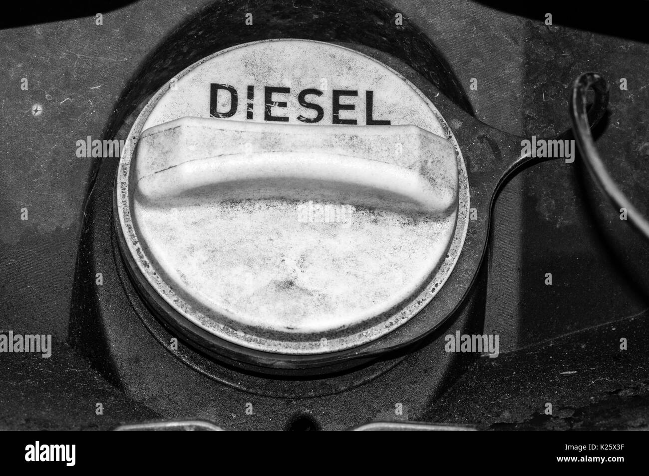 A black & white photograph of the messy filler cap of a diesel fuelled Land Rover.  See K0Y4EM for colour version. - Stock Image