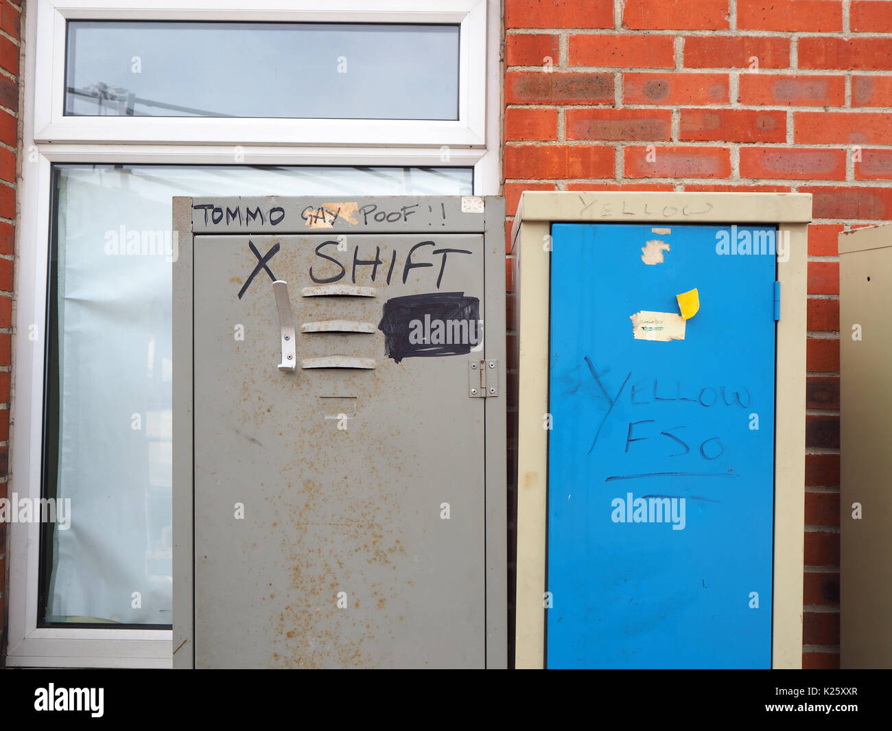 Changing room cabinets with homophobic graffiti - Stock Image