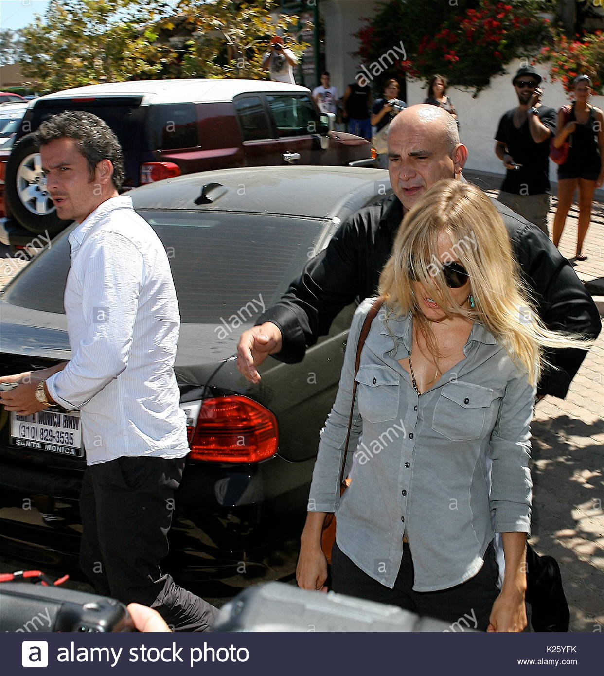 Sienna miller and balthazar getty stock photos sienna miller and sienna miller and balthazar getty sienna miller and balthazar getty went off in opposite directions publicscrutiny Images