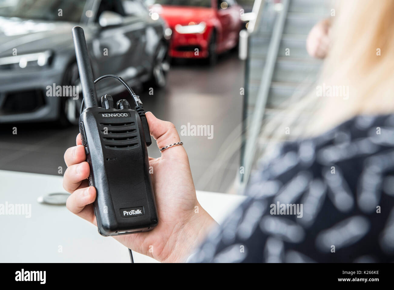 Walkie Talkies used for communication at a car dealership Stock Photo