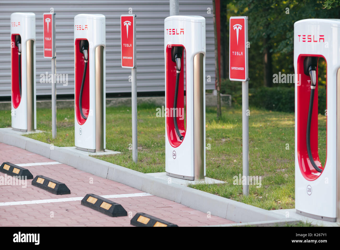 KATOWICE, POLAND - AUGUST 26, 2017: Tesla Supercharger station in Orlen Gas Station, Katowice. Tesla motors develops network of the charging stations  - Stock Image