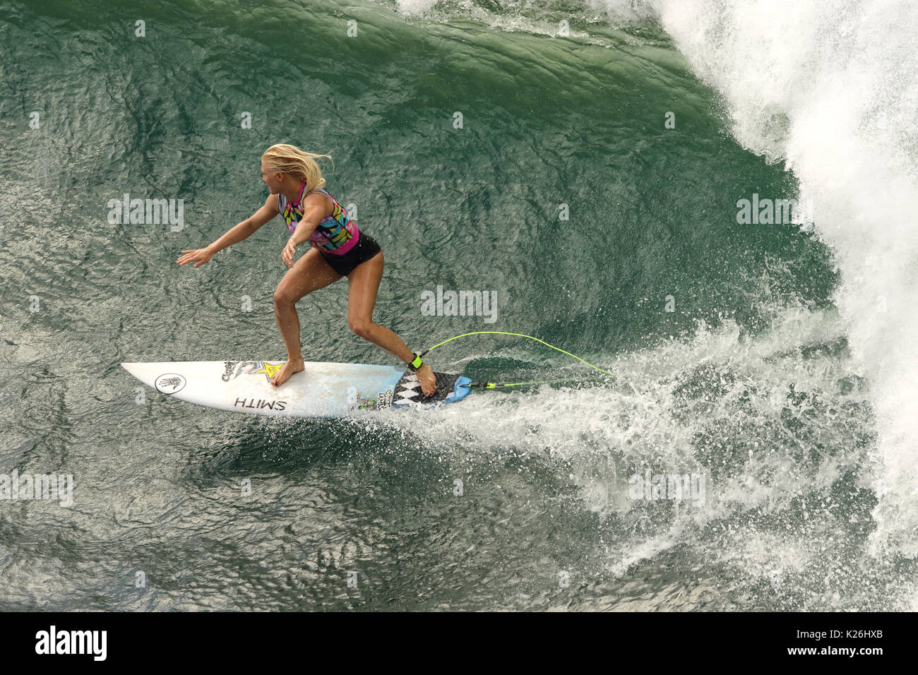 Women pro surfers at Honolua Bay on Maui. - Stock Image