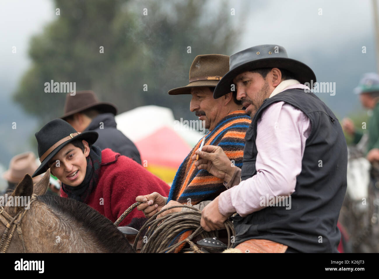 June 10, 2017 Toacazo, Ecuador: cowboys on their horse having a talk at a rural rodeo in the Andes - Stock Image