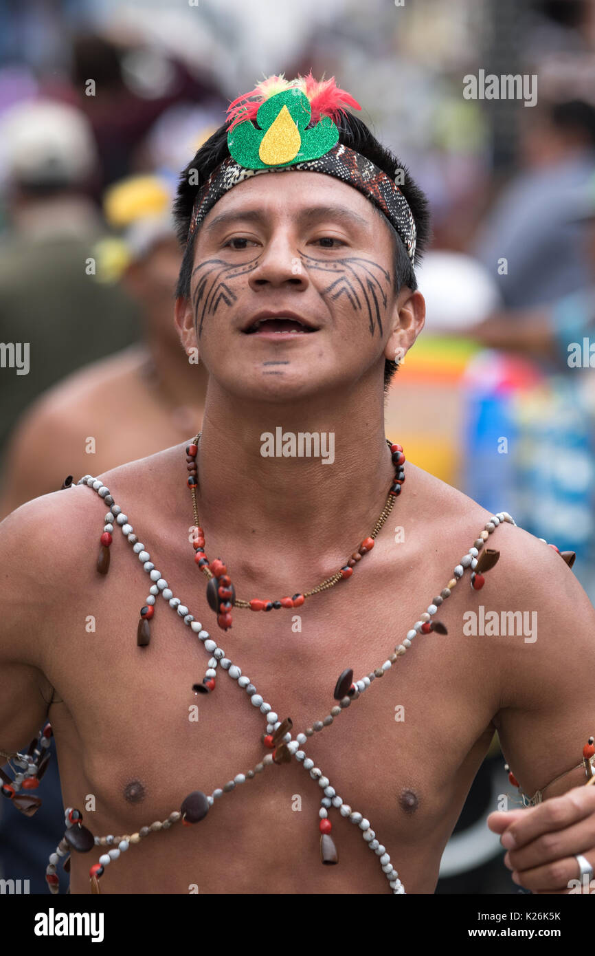 June 17, 2017 Pujili, Ecuador: bare chested indigenous man from the Amazon area dancing in the street at Corpus Christi parade - Stock Image