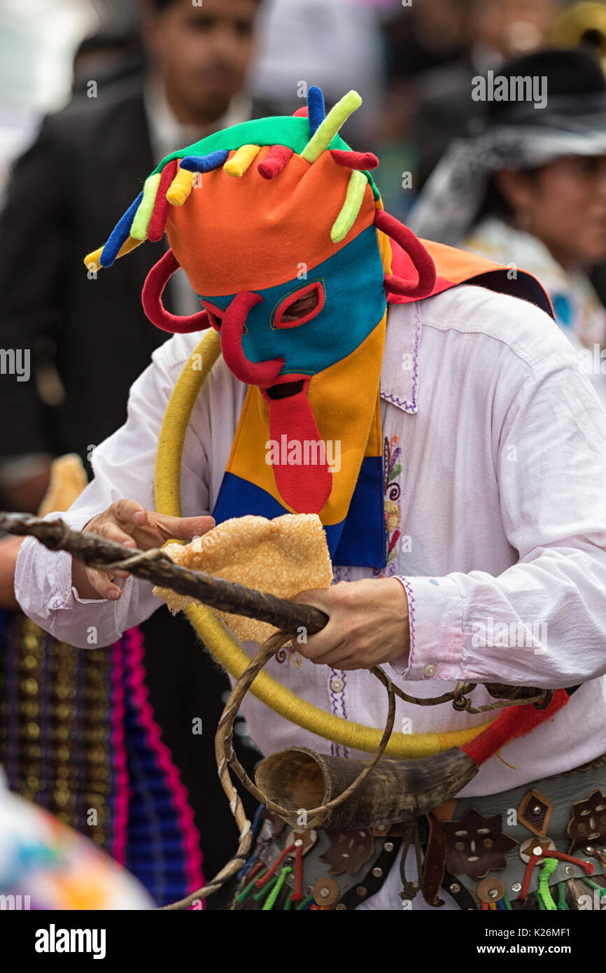June 17, 2017 Pujili, Ecuador: colorful traditional indigenous mask worn by male dancer at Corpus Christi parade Stock Photo
