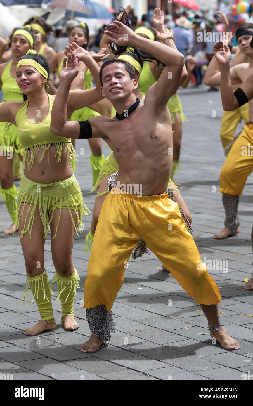 June 17, 2017 Pujili, Ecuador: young dancers in bright color costumes at Corpus Christi festival - Stock Image
