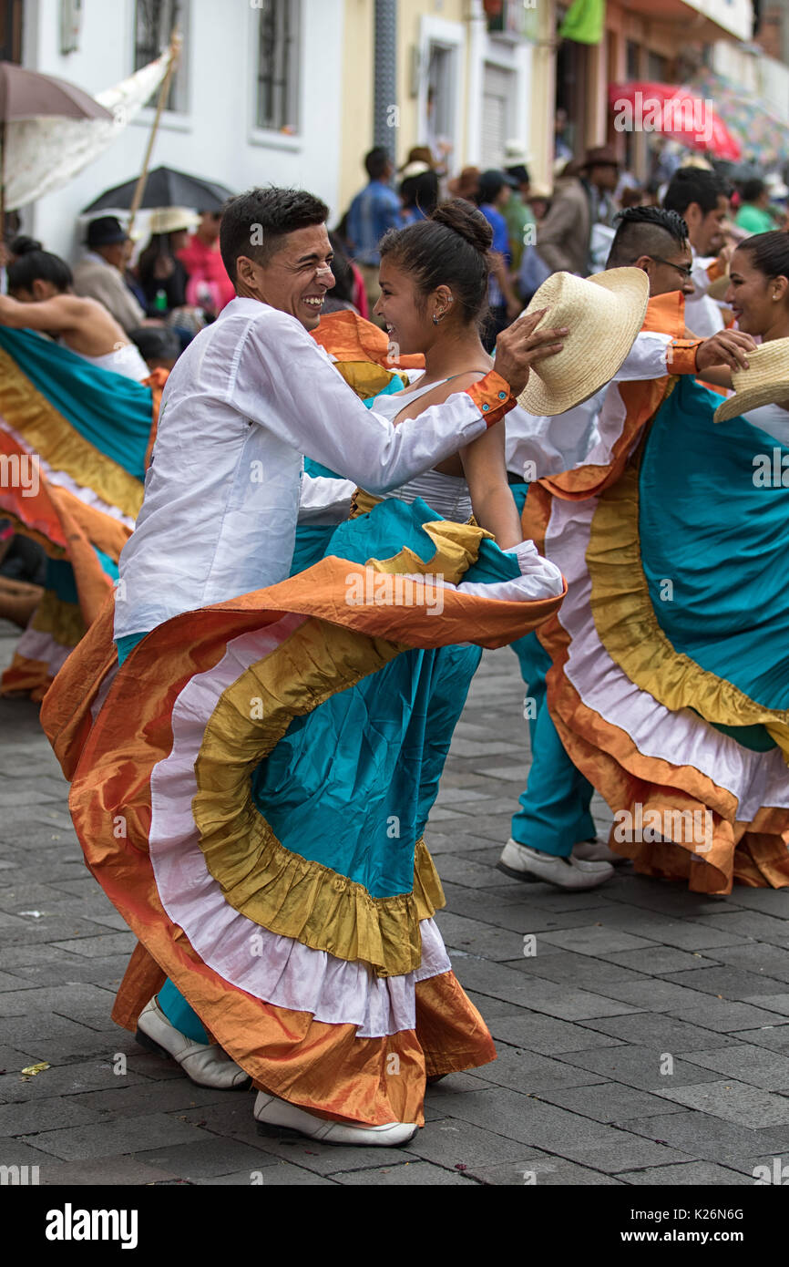 June 17, 2017 Pujili, Ecuador: indigenous couple dancing in colonial style dress at the Corpus Christi annual parade - Stock Image