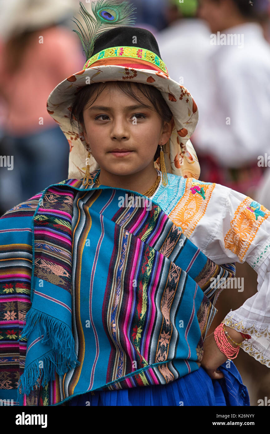 June 17, 2017 Pujili, Ecuador: young indigenous girl in bright color traditional clothing at Corpus Christi parade dancing in the street - Stock Image
