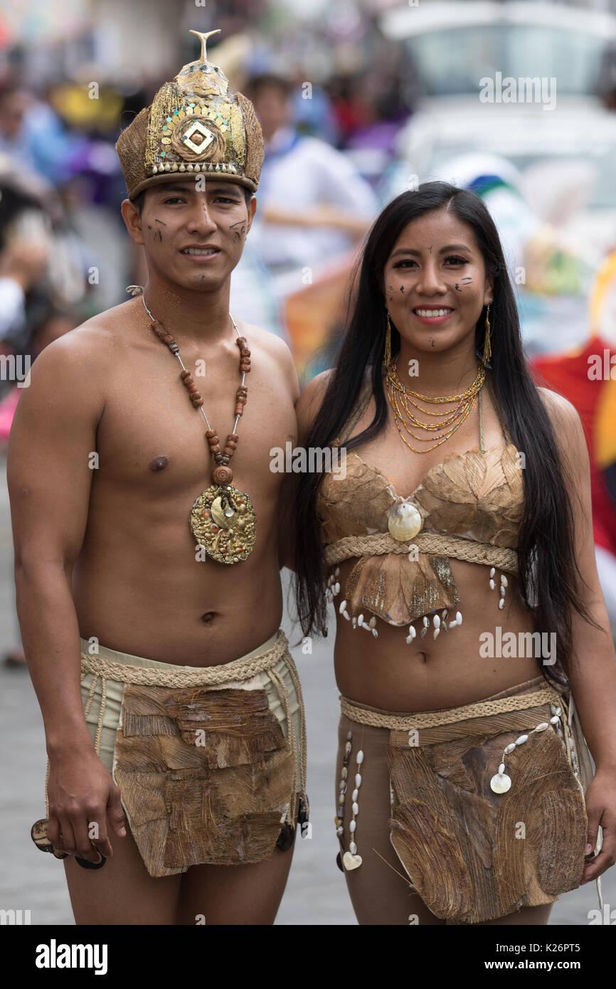June 17, 2017 Pujili, Ecuador: male and female dancers closeup from the Amazon area at the Corpus Christi festival - Stock Image