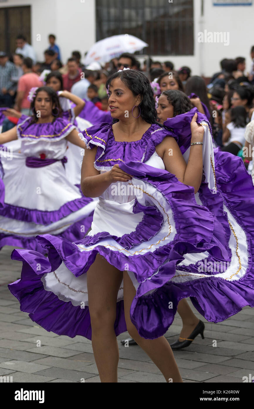 June 17, 2017 Pujili, Ecuador: female dancers dressed in traditional clothing in motion at the Corpus Christi annual Stock Photo