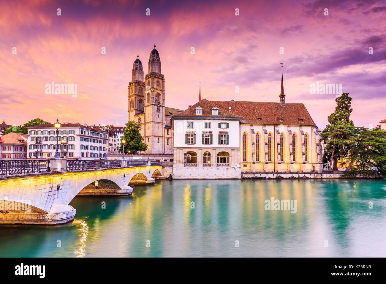 Zurich, Switzerland. View of the historic city center with famous Grossmunster Church, on the Limmat river. - Stock Image