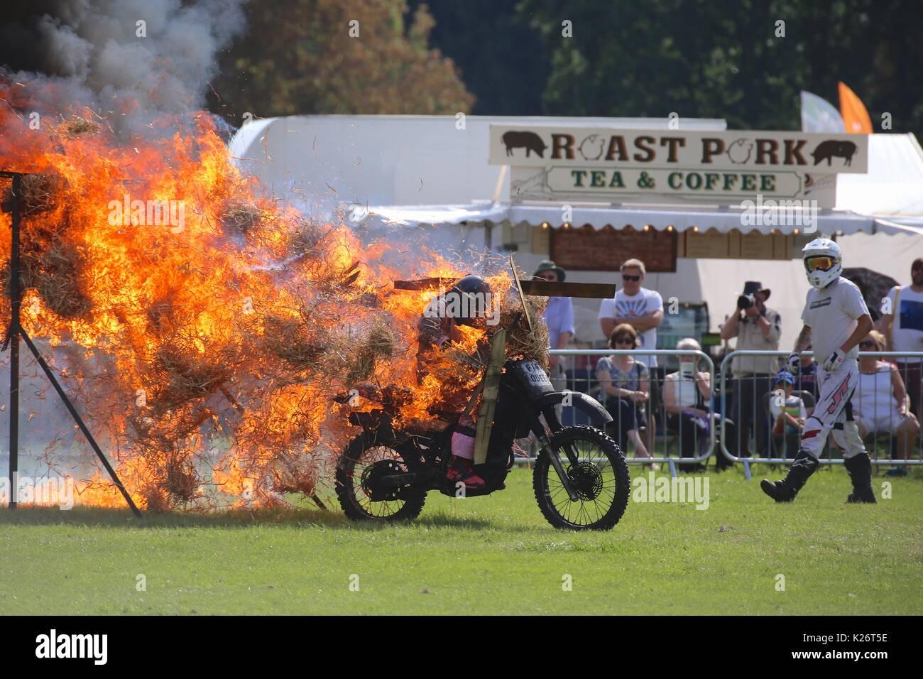 stunt bike on fire - Stock Image