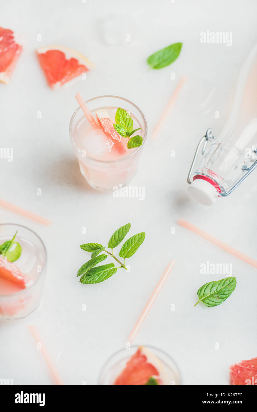 Cold refreshing summer alcohol cocktail with fresh grapefruit - Stock Image