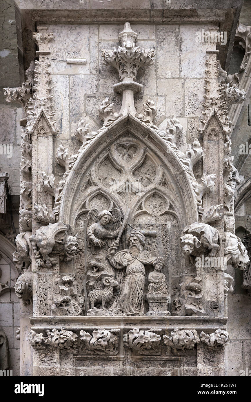 Relief of the sacrifice of Isaac by Abraham, portal of St. Peter's Cathedral, Regensburg, Upper Palatinate, Bavaria, Germany - Stock Image