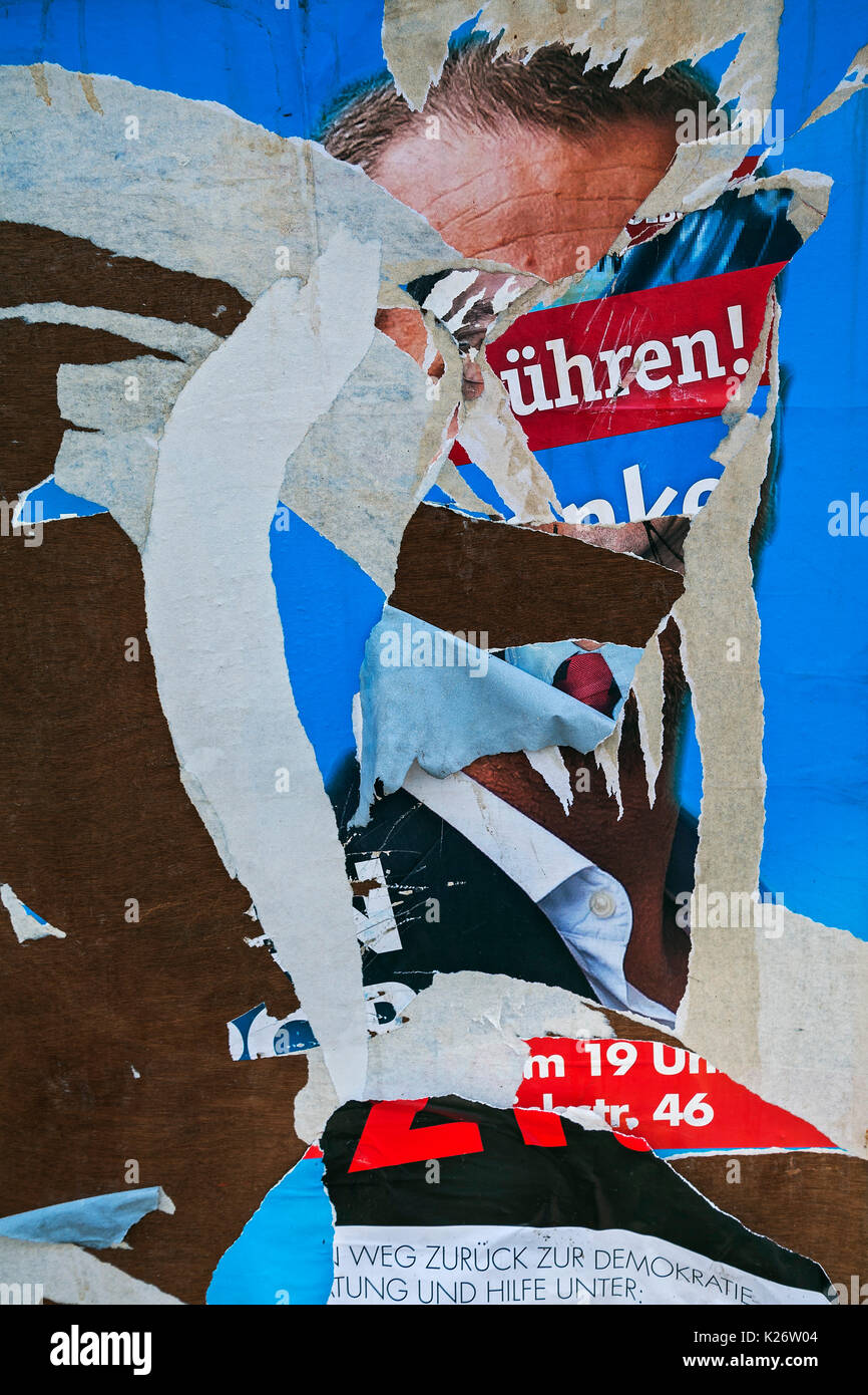 Torn electoral placard, Munich, Oberbayern, Bavaria, Germany - Stock Image