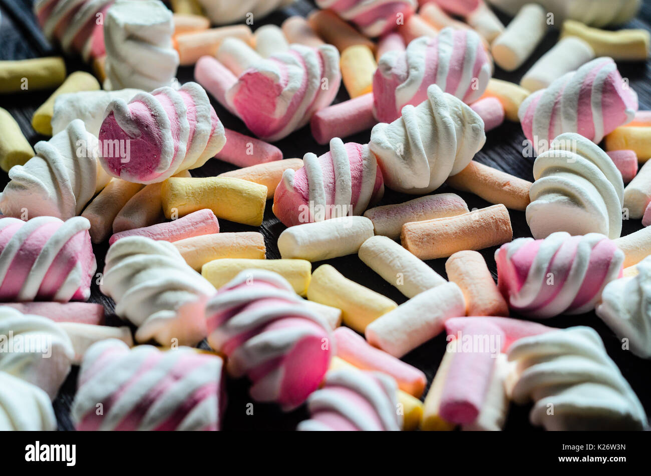Multicolored Marshmallow Background. Background of multi-colored and different in shape and size of marshmallows. Sweets background - Stock Image