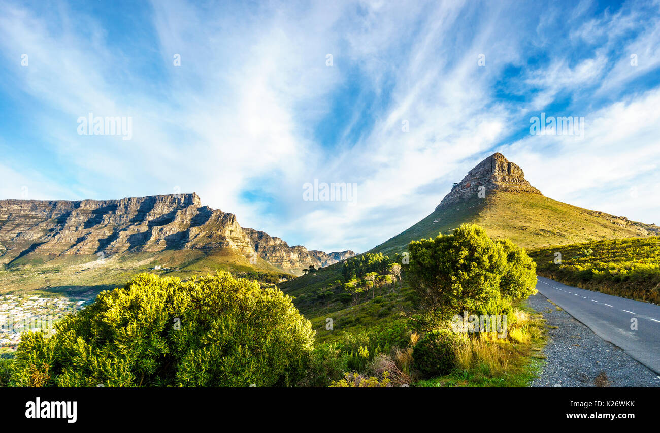 Sun setting over Table Mountain, Lions Head and the Twelve Apostles. Viewed from the road to Signal Hill at Cape Town, South Africa - Stock Image