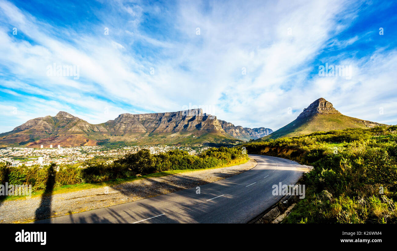 Sun setting over Cape Town, Table Mountain, Devils Peak, Lions Head and the Twelve Apostles. Viewed from Signal Hill at Cape Town, South Africa - Stock Image