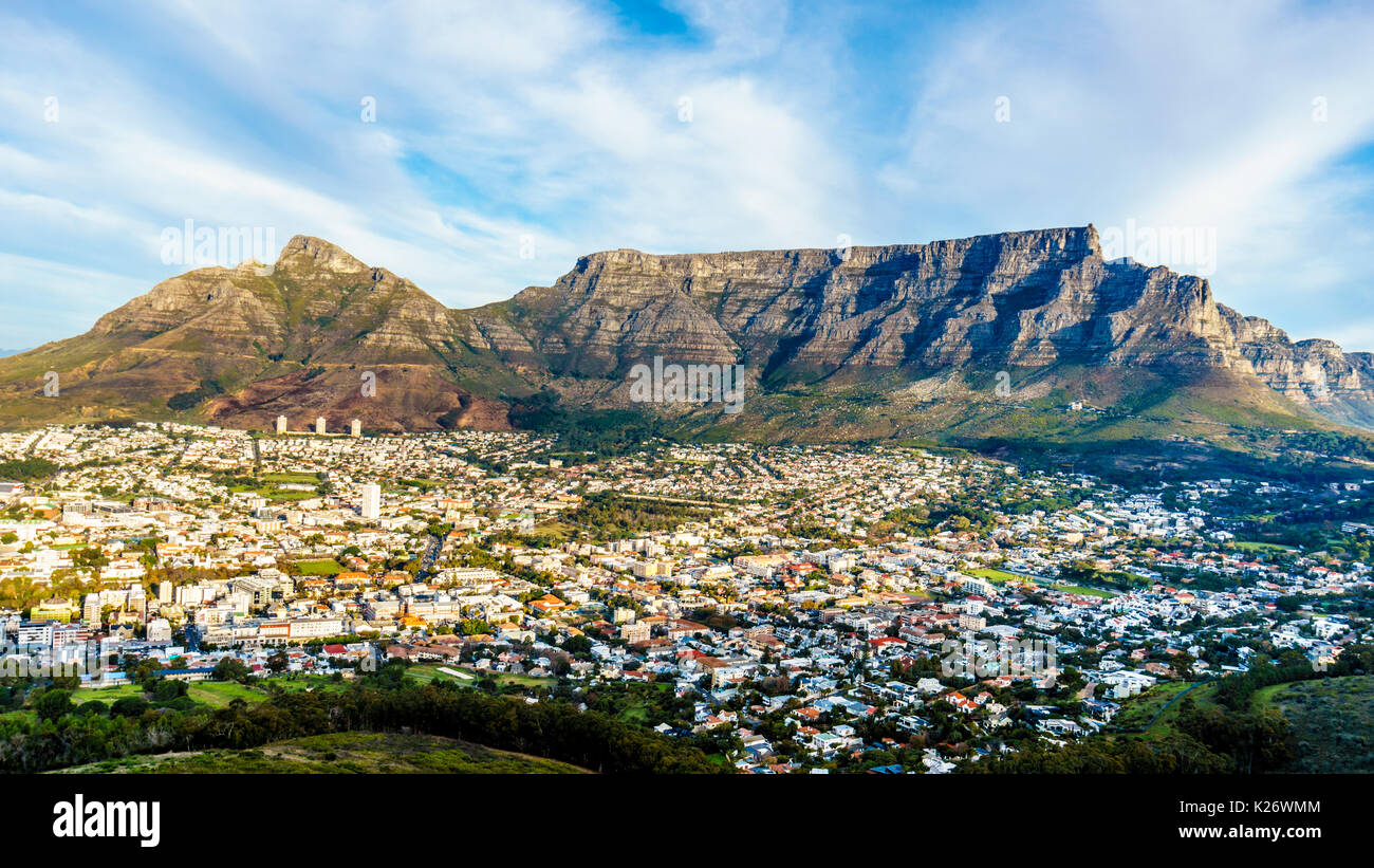 Sun setting over Cape Town, Table Mountain, Devils Peak, Lions Head and the Twelve Apostles. Viewed from the road to Signal Hill at Cape Town, South A - Stock Image