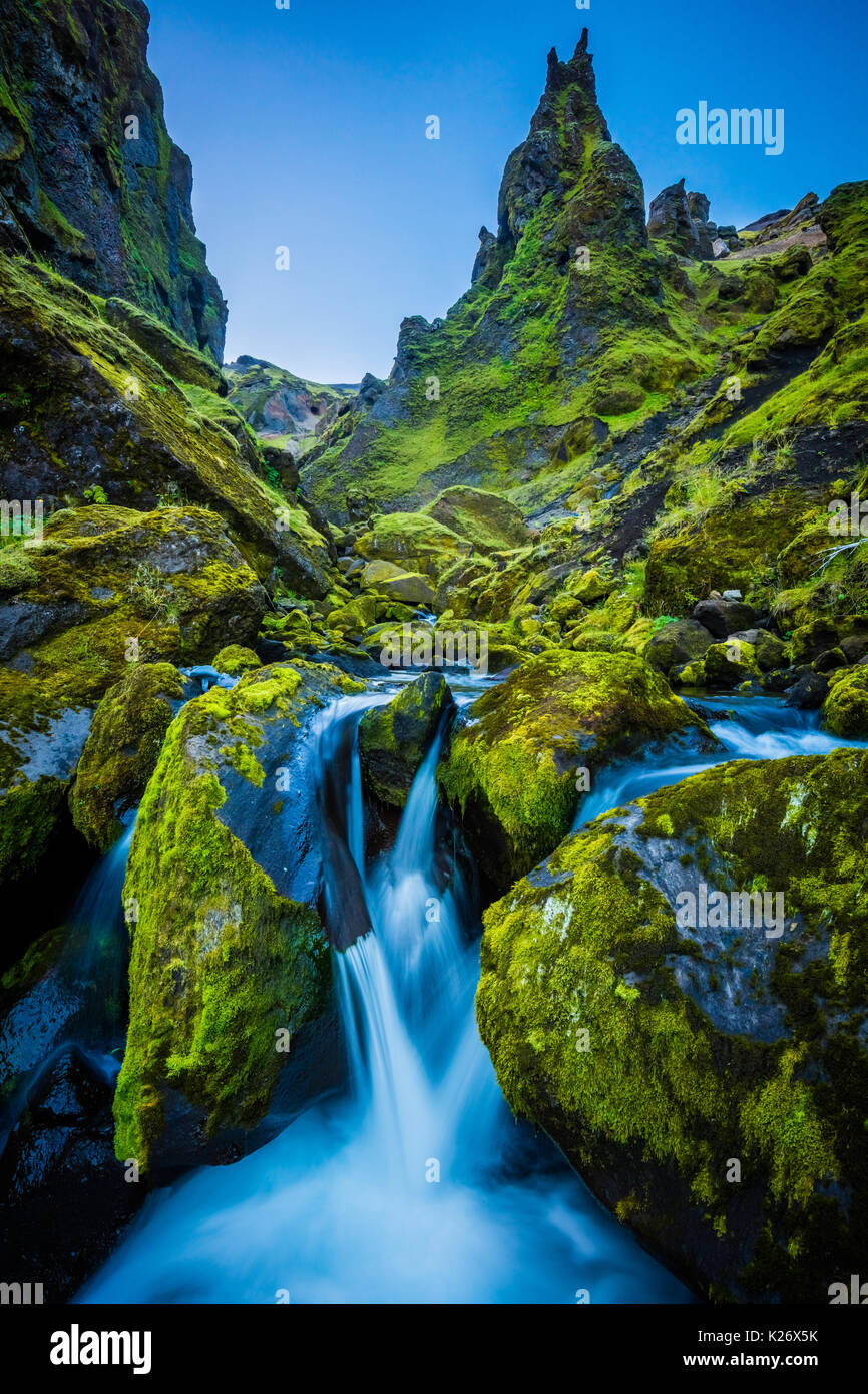 Moss, rocks, and cascading water at Thakgil Canyon - Stock Image