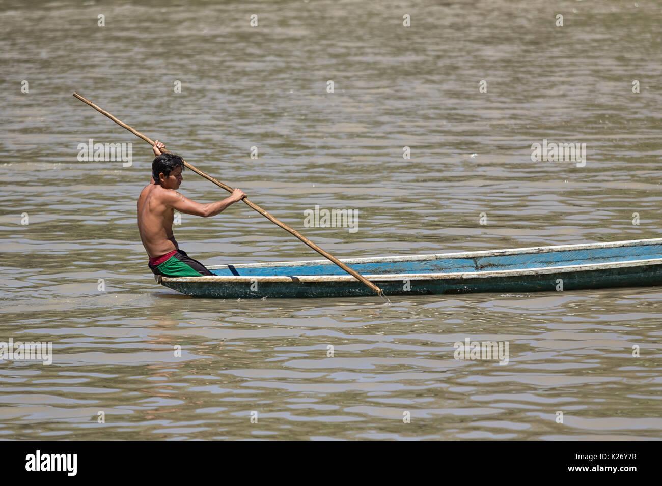 June 6, 2017 Misahualli, Ecuador:  indigenous man in canoe on the Napo river in the Amazon area - Stock Image