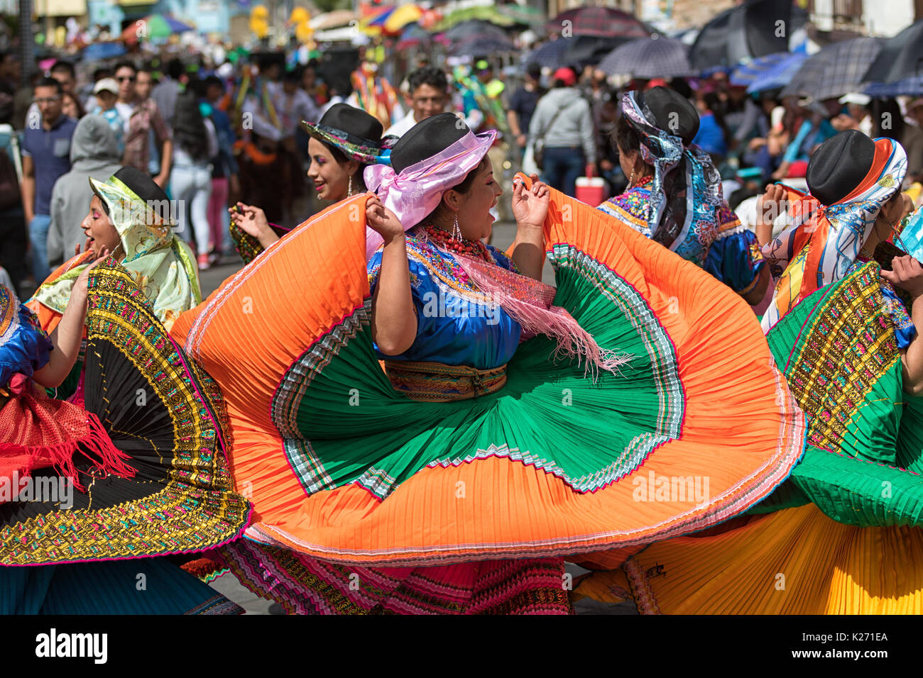 June 17, 2017 Pujili, Ecuador: female dancer group  in traditional clothing in motion at the Corpus Christi annual parade - Stock Image