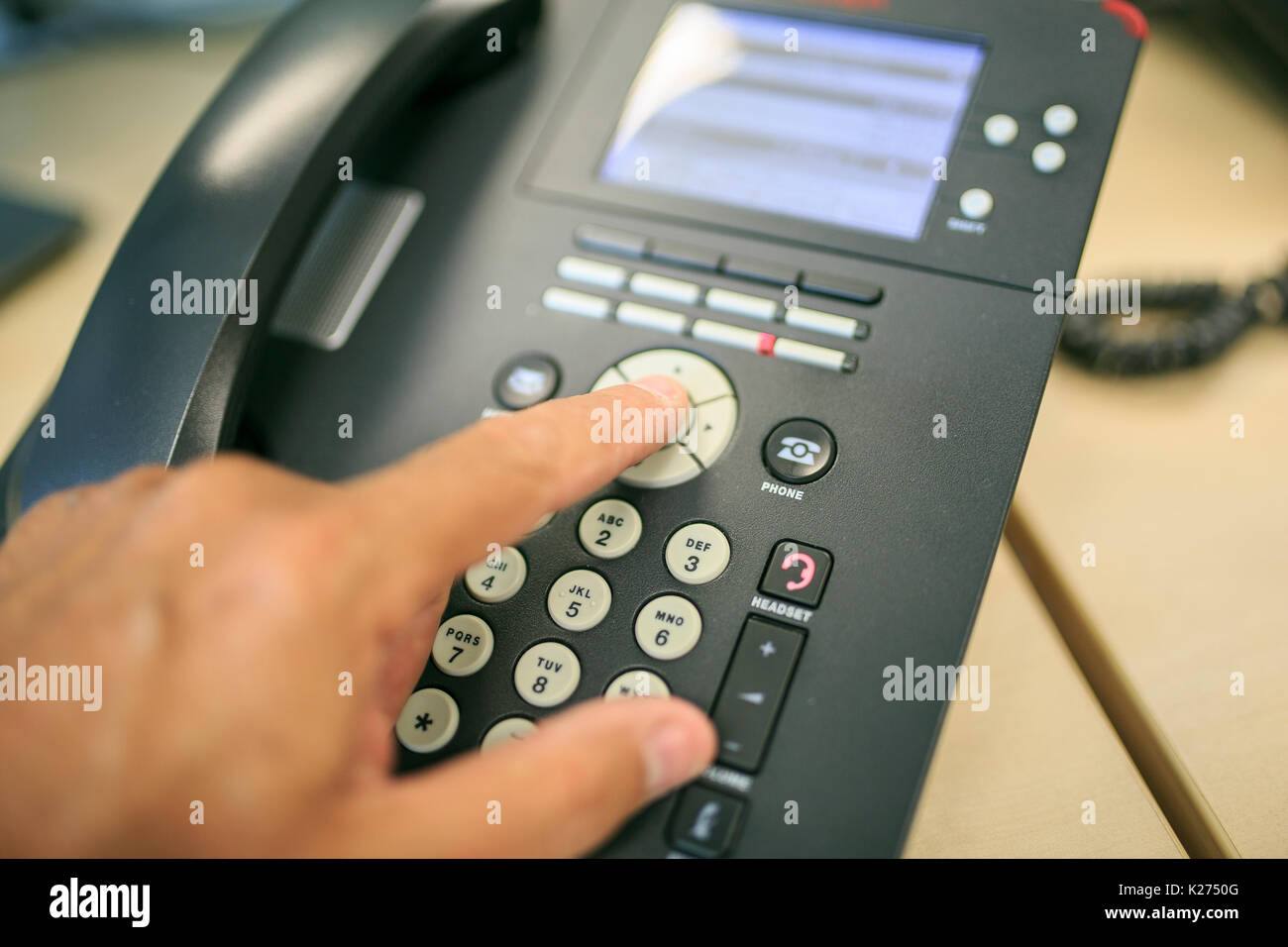 making a call in a black telephone - Stock Image