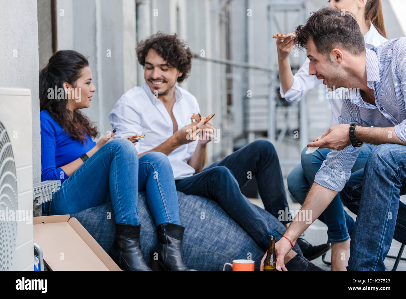 Team of Creative industries agency during lunch at office balcon - Stock Image