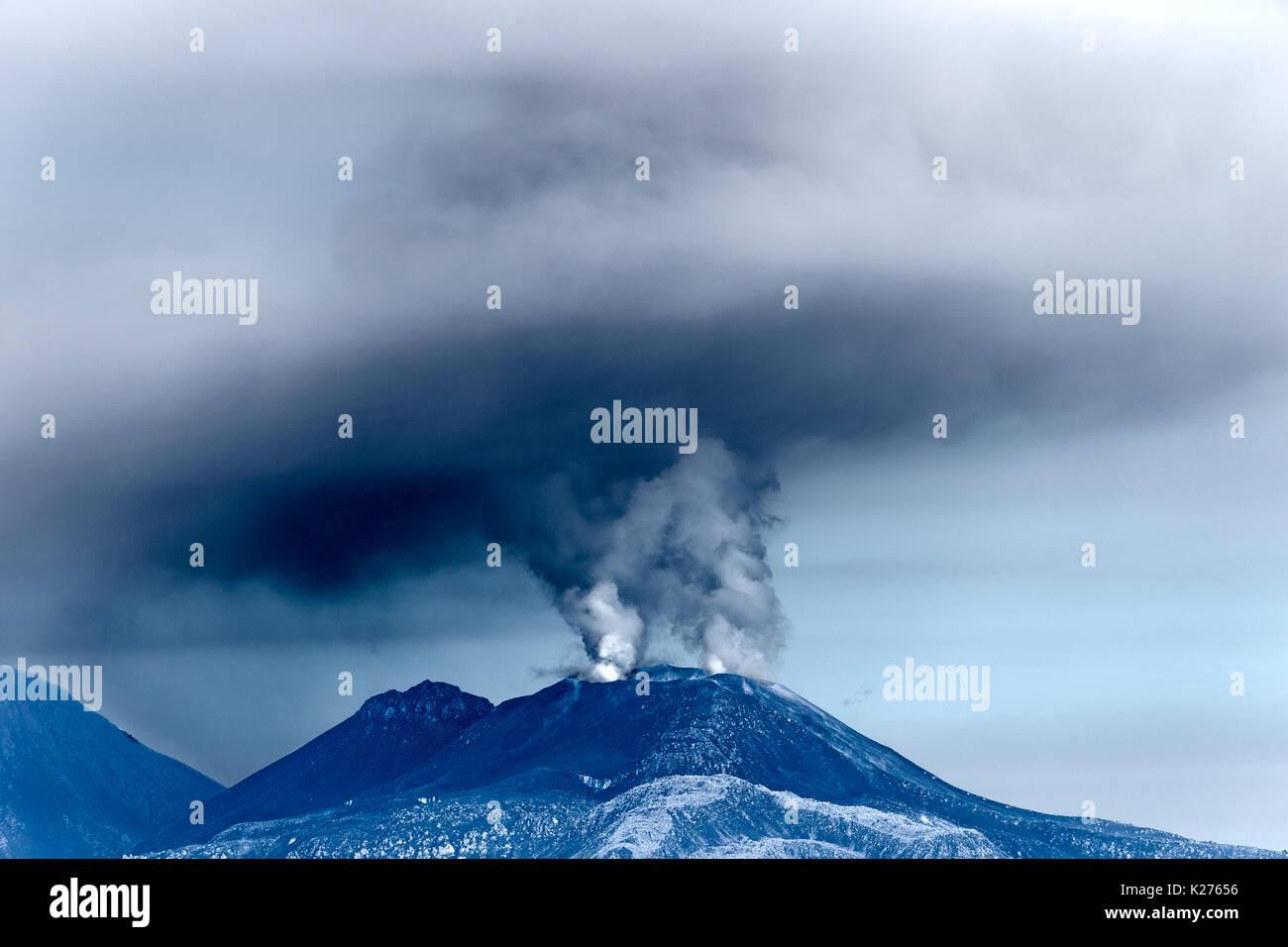 Savancaya Volcano (with plume) plus Ampato Momia Juanita (Spanish for 'Mummy Juanita'), aka the 'Inca' Ice Maiden was found on it (left). Peru - Stock Image
