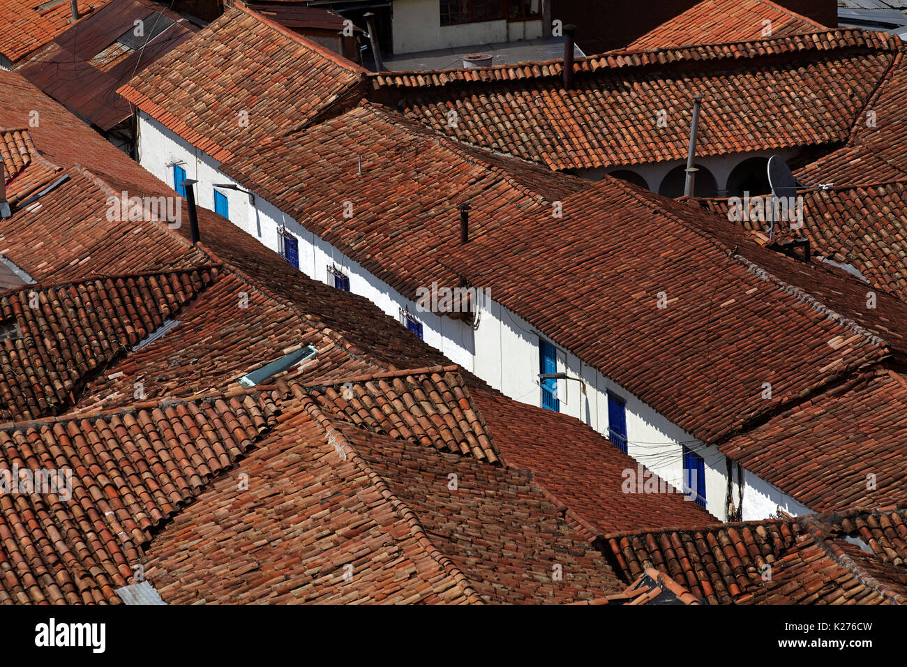 Terracotta tiled roofs along Procuradores, Cusco (World Heritage Site), Peru, South America - Stock Image