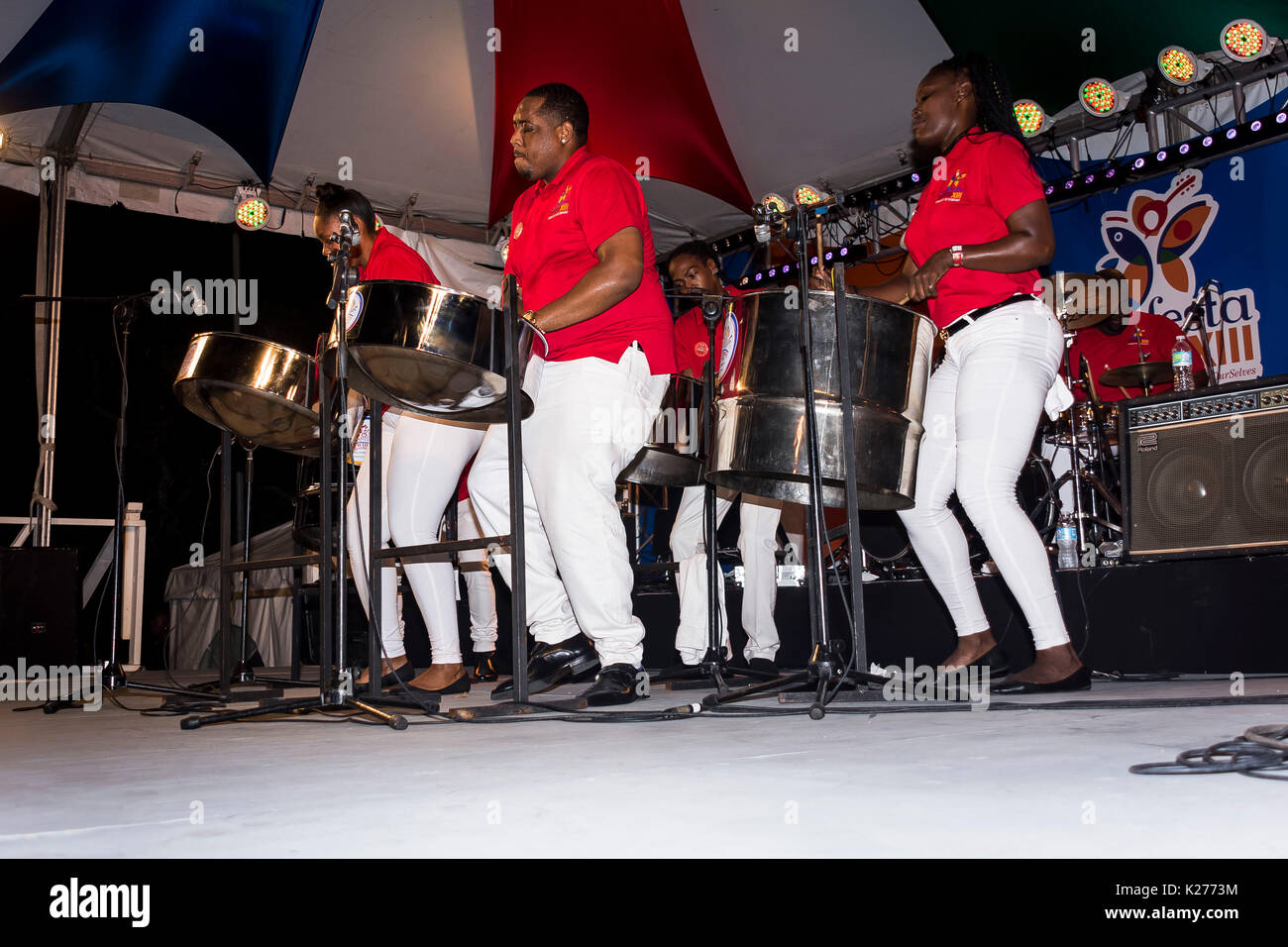 CARIFESTA X111 IN BARBADOS; SPICE AND COMPANY; AARON DUNCAN; CLAUDETTE PETERS PERFORMING - Stock Image