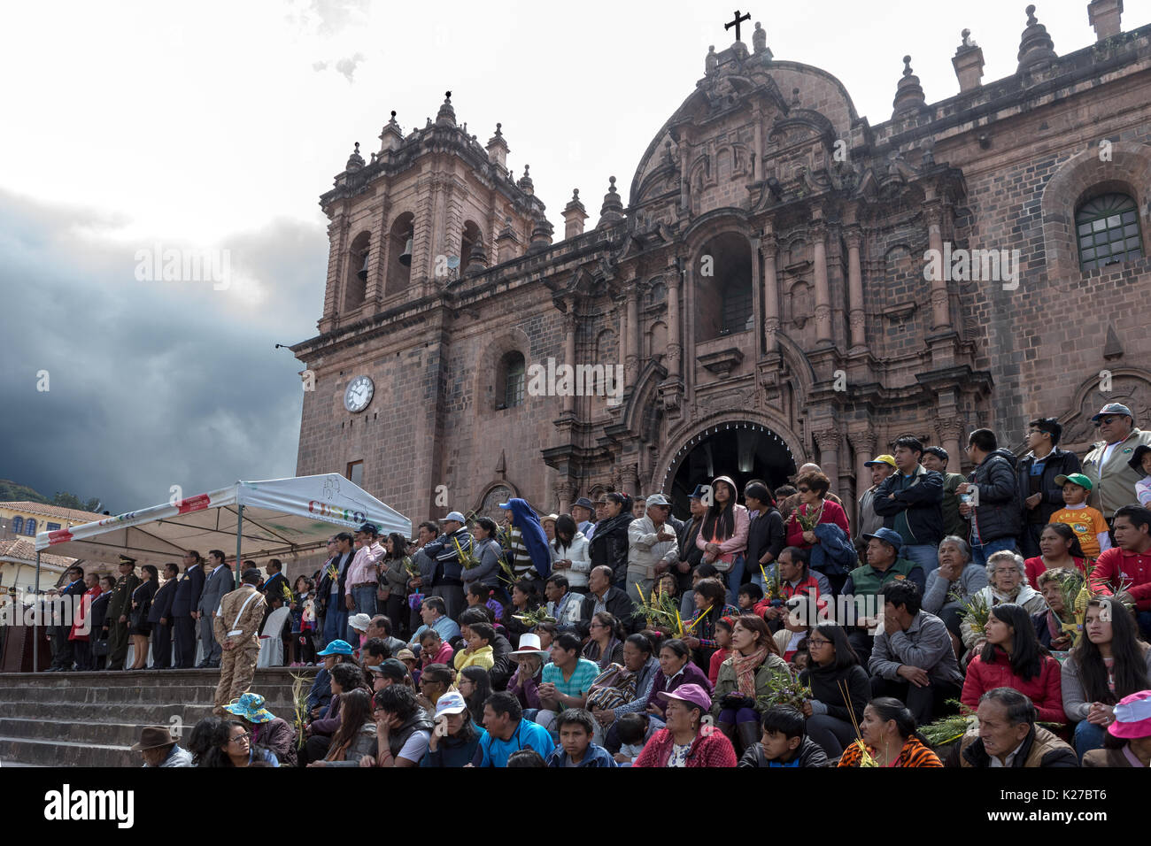 Crowds and Officials outside The Cathedral Palm Sunday Celebrations Plaza de Armas Cusco Peru - Stock Image