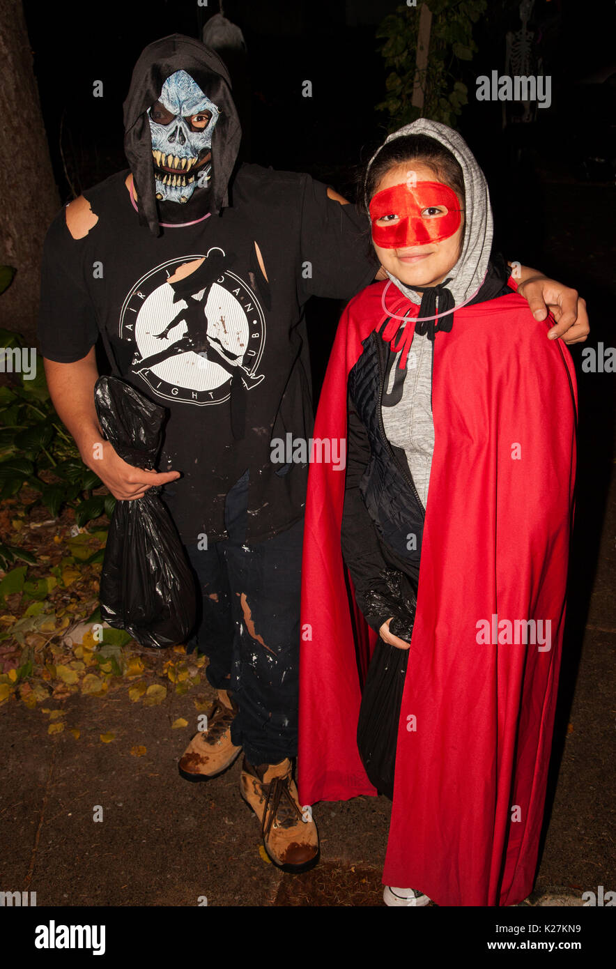 Halloween couple monster and Red Riding Hood trick or treating.  St Paul Minnesota MN USA - Stock Image