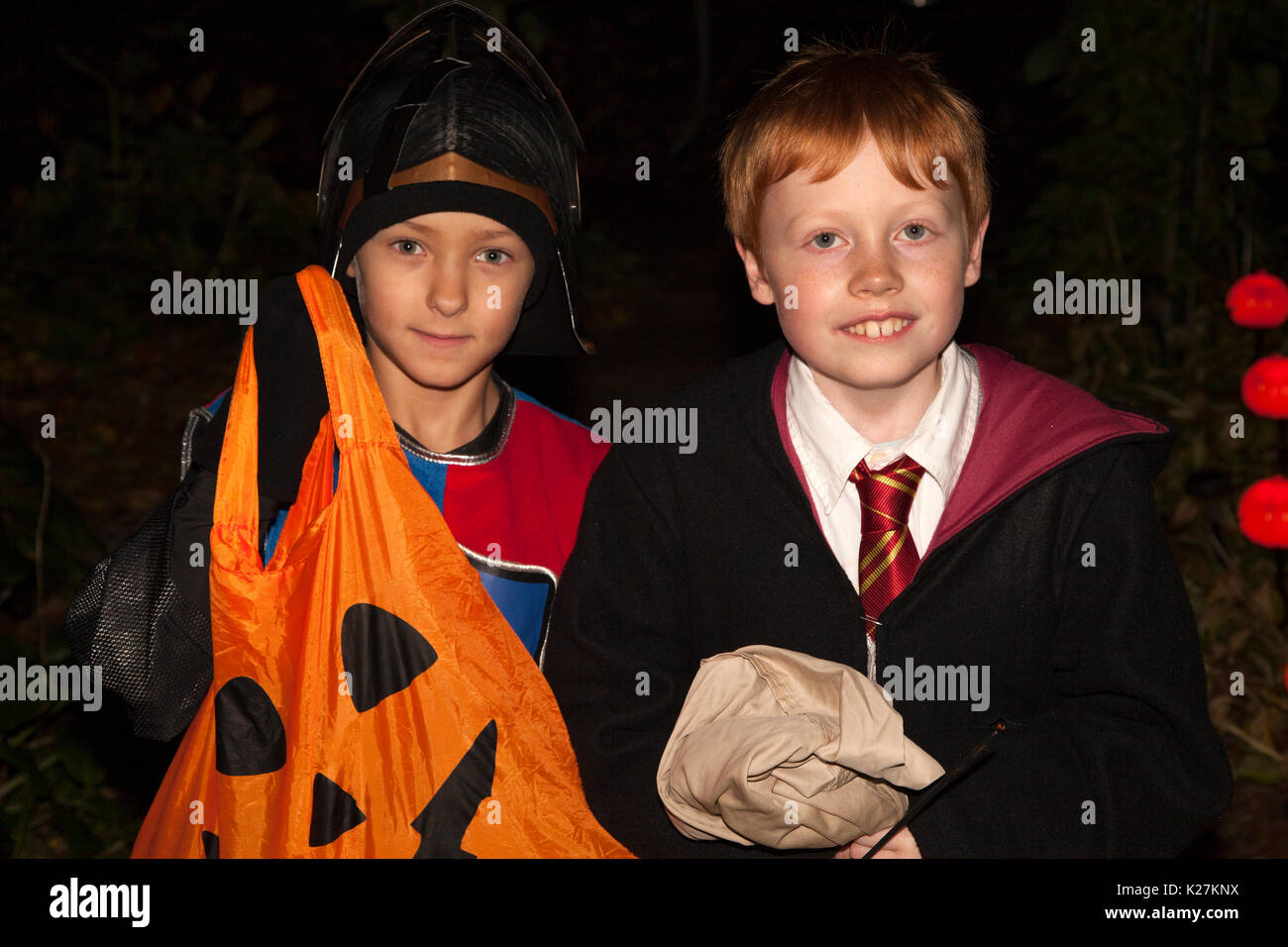 Halloween costumed characters right out of a Harry Potter adventure trick or treating. St Paul Minnesota MN USA - Stock Image