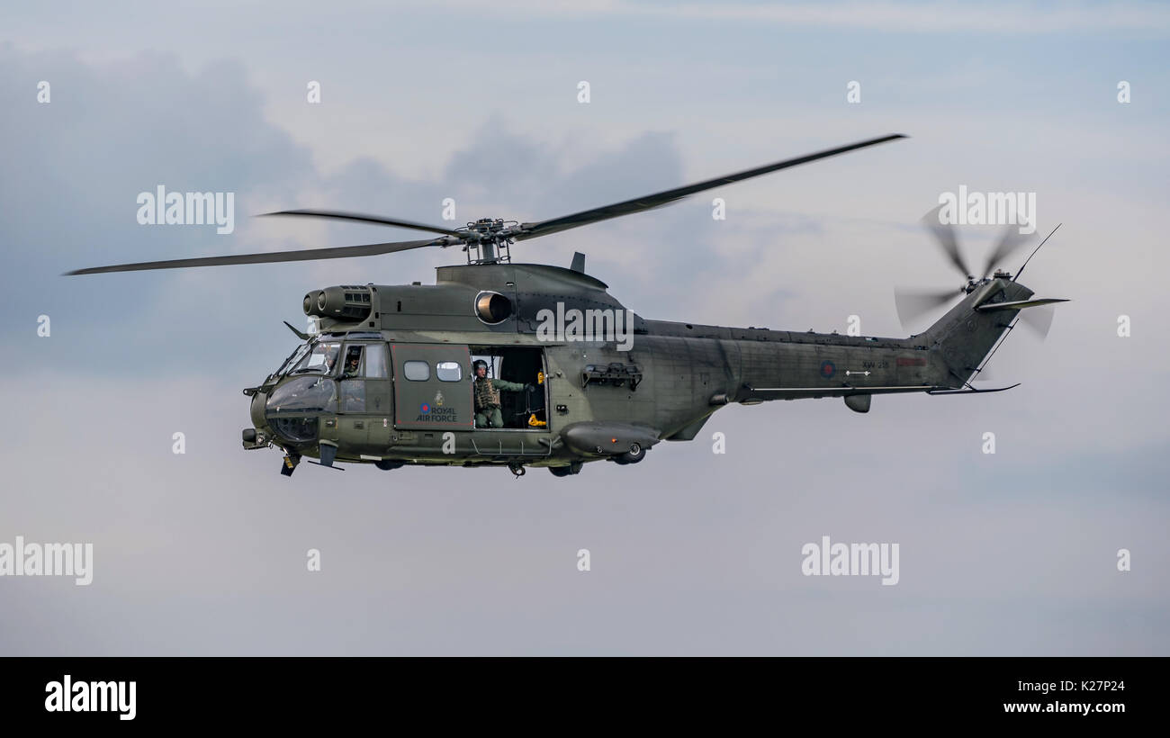 RAF Puma HC2 helicopter in flight at the Dunsfold Wings & Wheels Airshow, UK on the 26th August 2017. - Stock Image