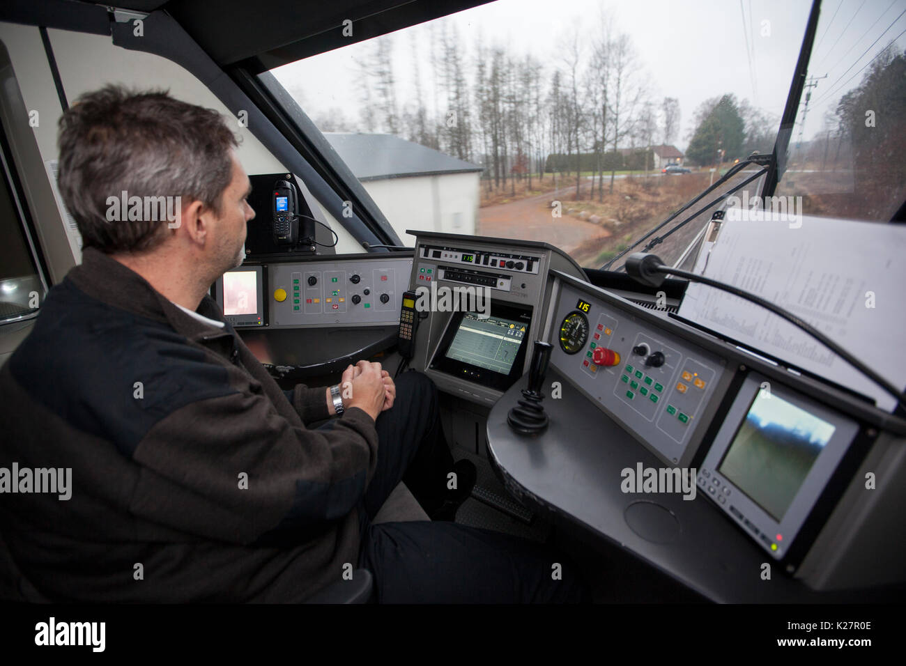 Locomotive driver in his cabin, Skåne, Sweden. - Stock Image