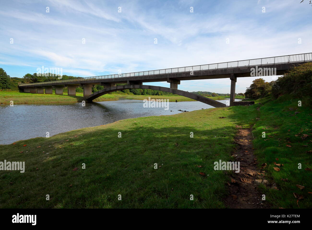 The Welsh water road bridge to allow access to the Ogmore sewerage plant on the opposite bank of the river Ogmore. Stock Photo