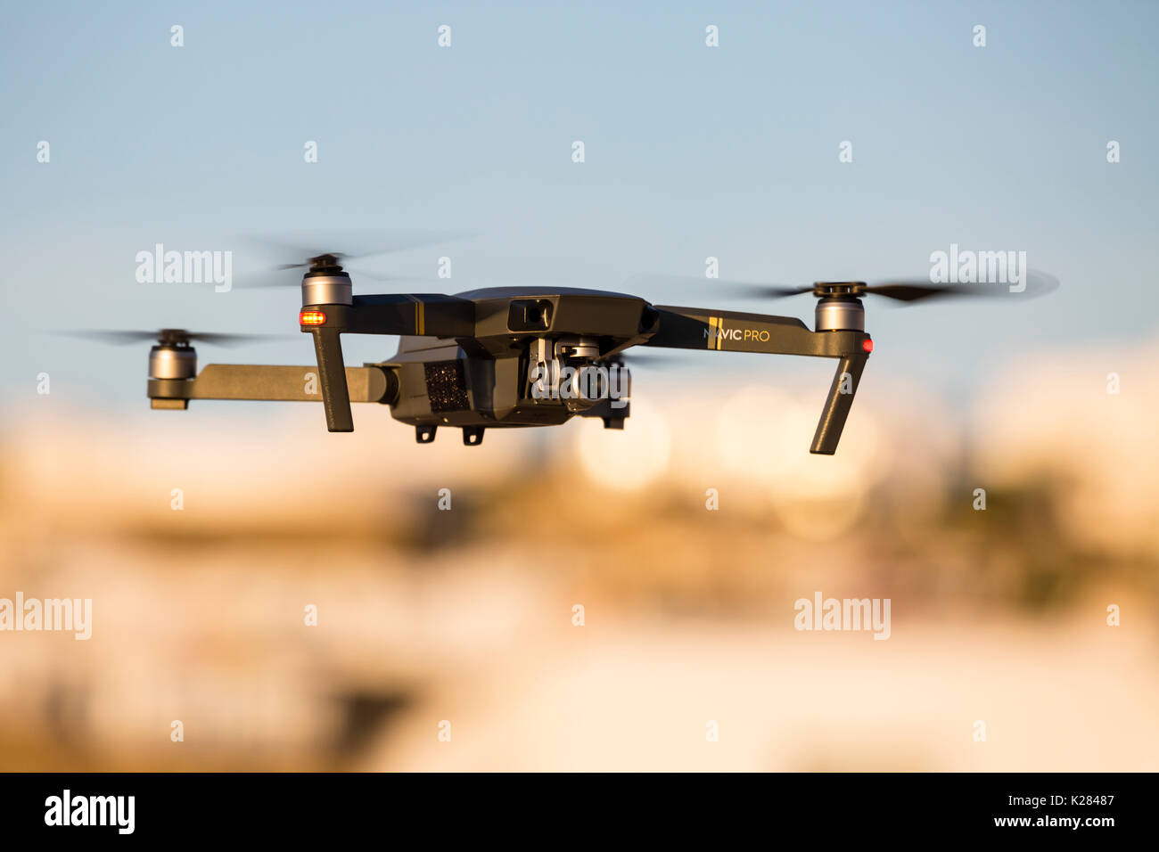 Mavic Pro quadcopter drone in flight. - Stock Image