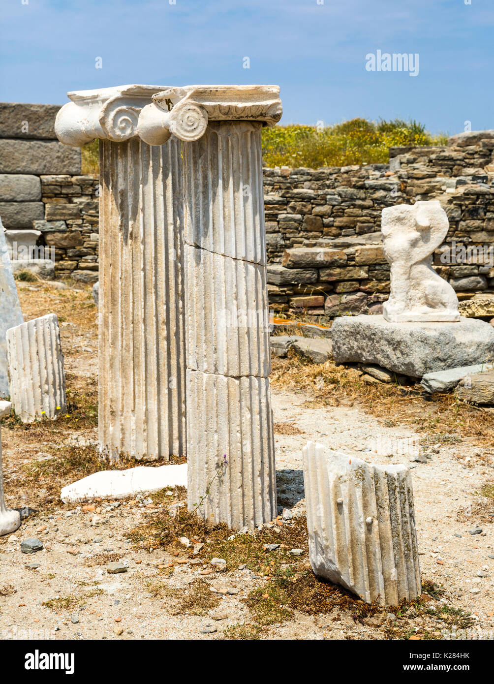 Ancient Greek Ionic fluted columns, Delos ruins, Greece. - Stock Image