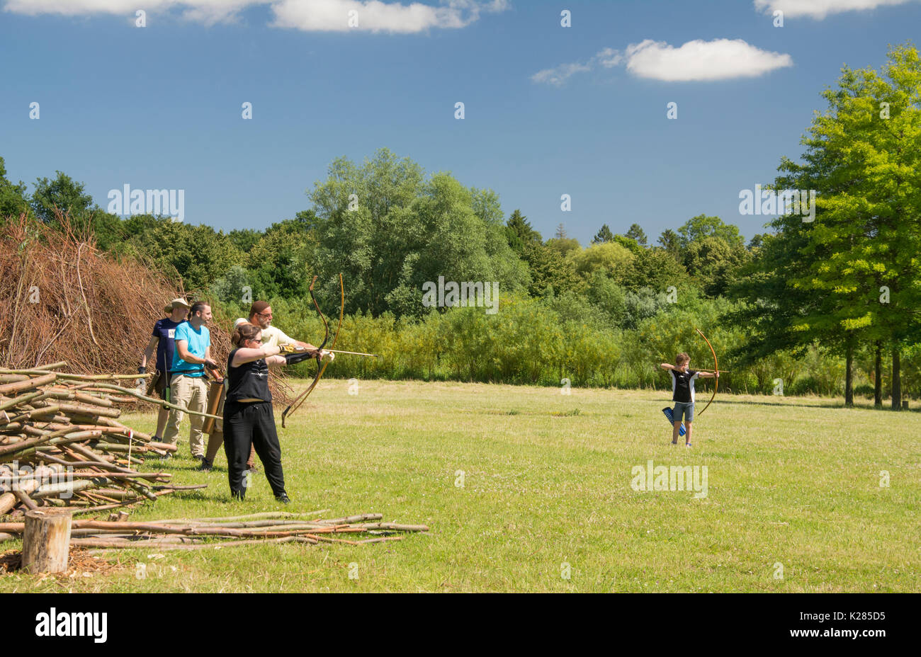 Archers take part in re-enacting life in a medieval Slav community at the Oldenburger Wallmuseum in Oldenburg-in-Holstein, Germany - Stock Image