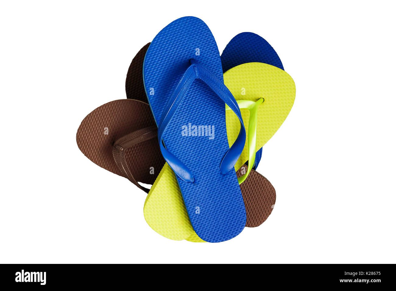 af617d58e124 A stack of several pairs of multi-colored rubber flip-flops Stock ...