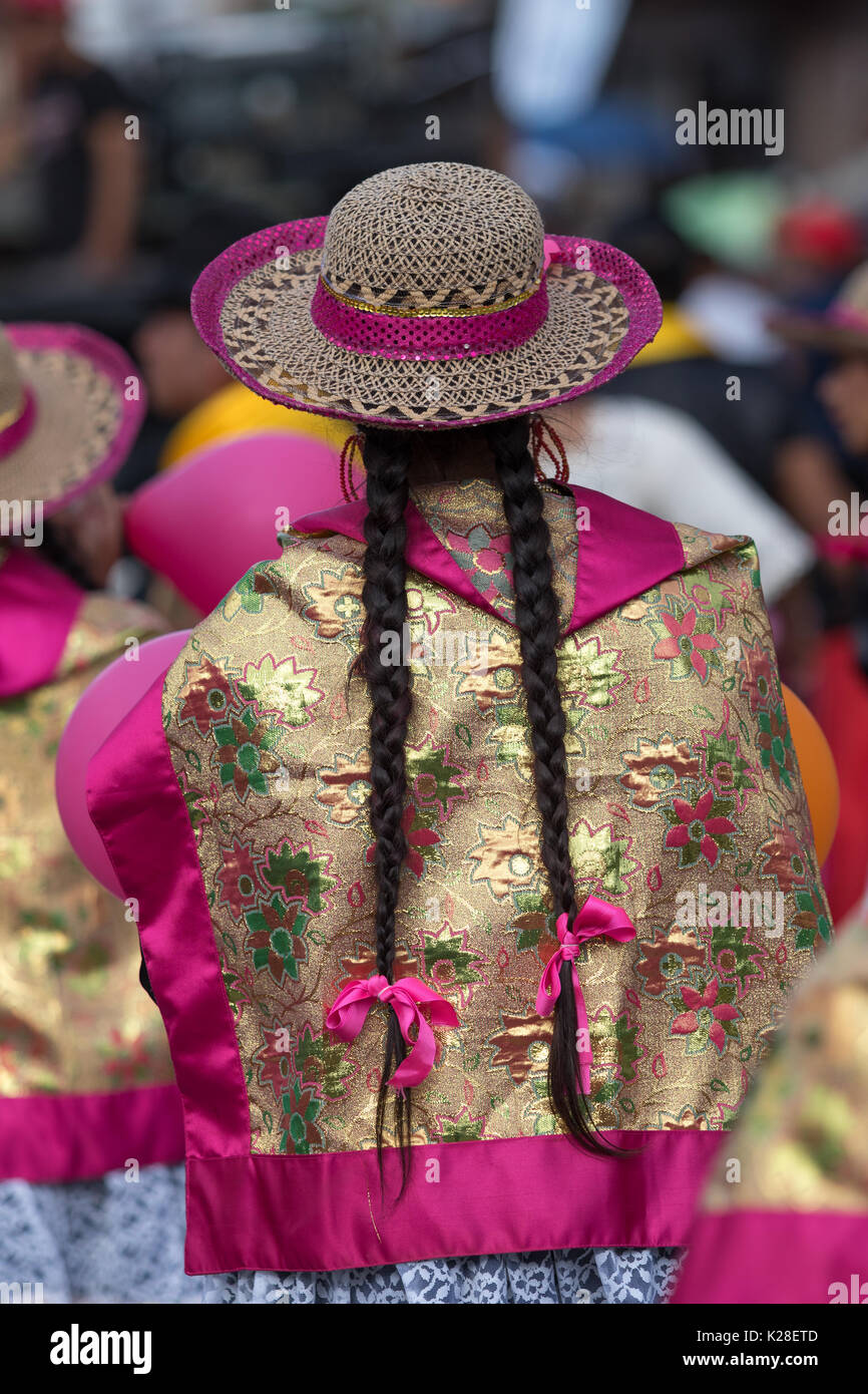 June 17, 2017 Pujili, Ecuador: closeup of a female dancer with colorful traditional clothing  at the Corpus Christi annual parade - Stock Image