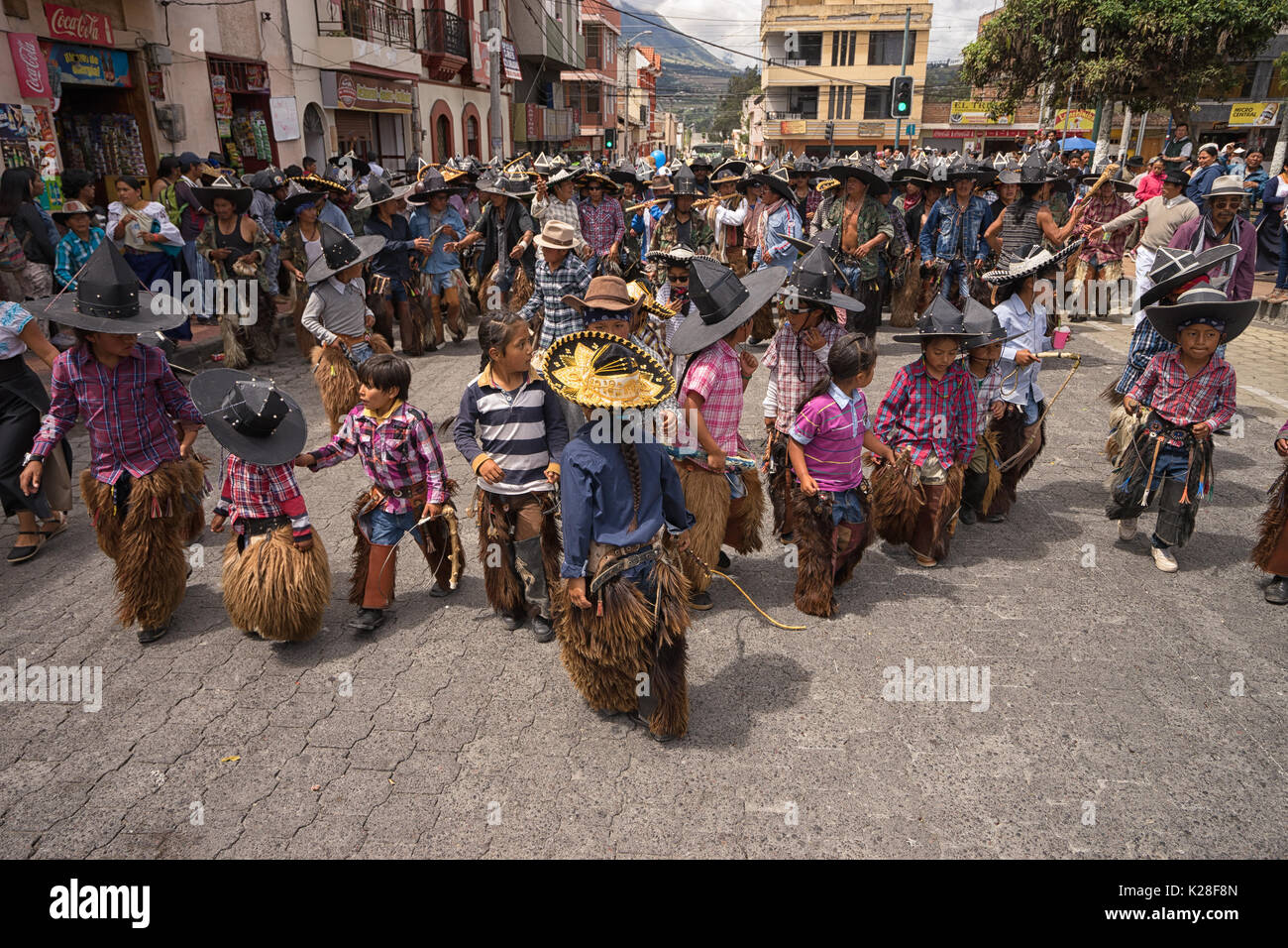 June 25, 2017 Cotacachi, Ecuador: children wearing sombreros and chaps at the the Inti Raymi celebrations - Stock Image