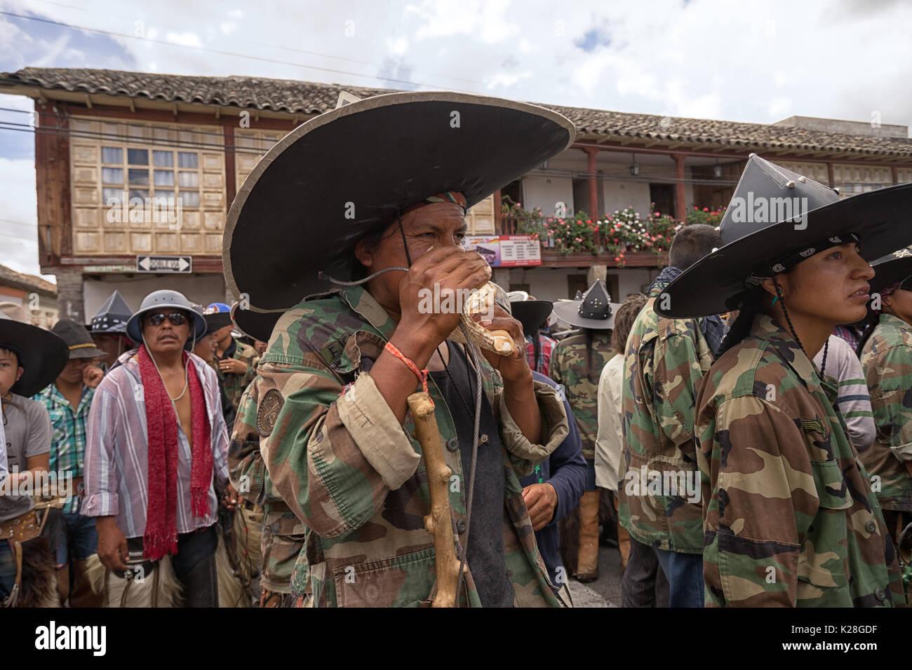 June 25, 2017 Cotacachi, Ecuador: indigenous kichwa man using the seashell horn at the Inti Raymi parade - Stock Image