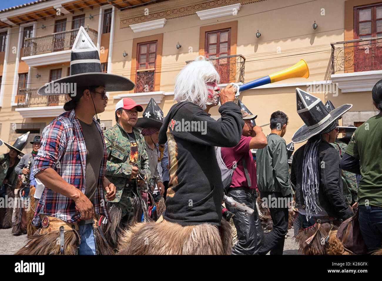 June 25, 2017 Cotacachi, Ecuador: male indigenous dancers during the 'occupy the plaza' parade at Inti Raymi celebrations - Stock Image