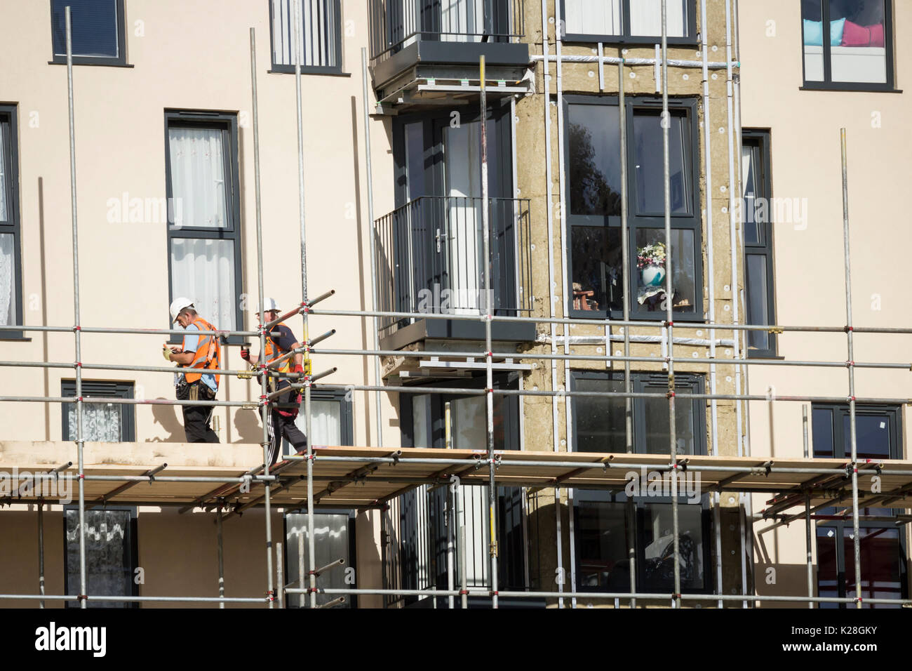 UK: Cladding being removed from tower blocks at Kennedy Gardens in Billingham, north east England. - Stock Image